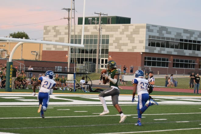 Basehor-Linwood tight end Chants Nelson makes a catch before rolling into the endzone for a 34-yard touchdown in Friday's 26-21 win against Center.