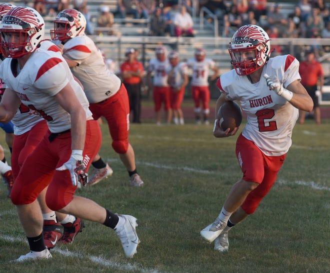 Isaac Smith of New Boston Huron runs for a touchdown Friday night.