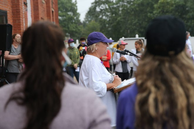 Framingham resident Stephanie Deeley speaks about her late sister, Kimberly Parker, who was a victim of domestic violence, during the 10th Purple Passion 5K event, put on by Voices Against Violence in Framingham, Sep. 18, 2021.