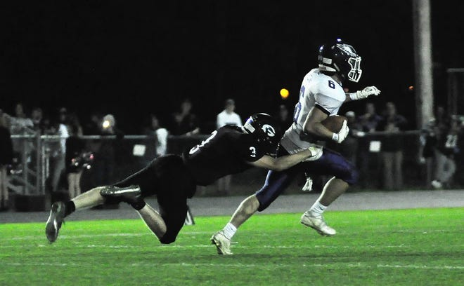 Ty Cougler, right, and the Marshwood High School football team will host South Portland on Friday. Kickoff is scheduled for 6 p.m.