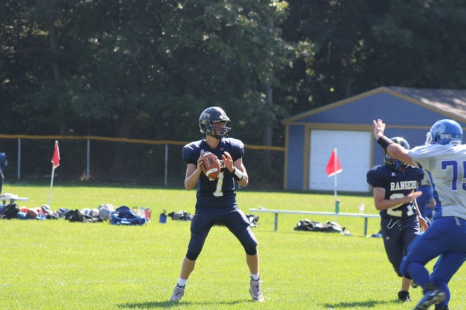 Traip Academy quarterback Zac Foye looks to make a pass during the second quarter of Traip's loss on Saturday to Sacopee Valley.