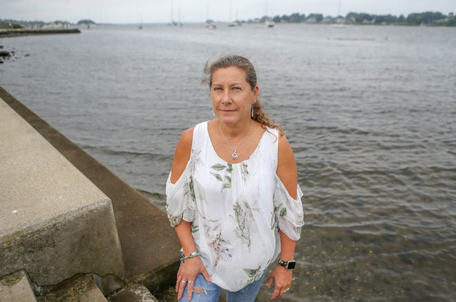 Sheri Boucher, an Air Force flight nurse who served in Afghanistan. lives in Warren with her family. She is shown here at Warren Town Beach.