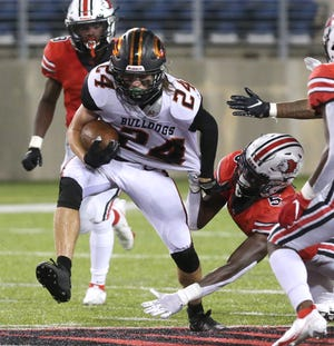 Jack Schaal, 24, of Green picks up yardage while being defended from behind by Harold Fannin, 5, of McKInley during their game at McKinley on Friday, Sept. 17, 2021.