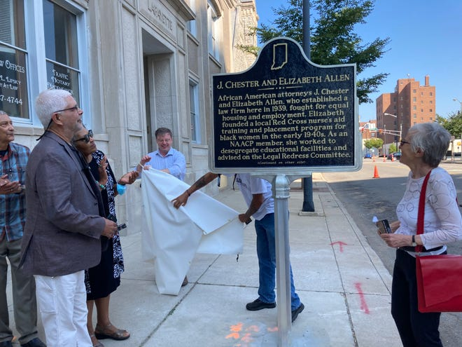South Bend Mayor James Mueller, center, helps unveil a historical marker for husband-wife attorneys and civil rights figures J. Chester and Elizabeth Allen on Saturday, Sept. 18, while historian Gabrielle Robinson, right, and Allen family members look on.