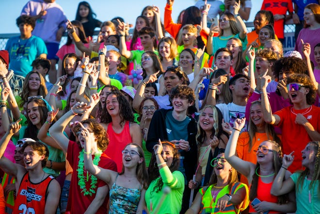 Marian students cheer during the Marian vs. Adams High School football game Friday, Sept. 17, 2021 at Marian High School in South Bend.