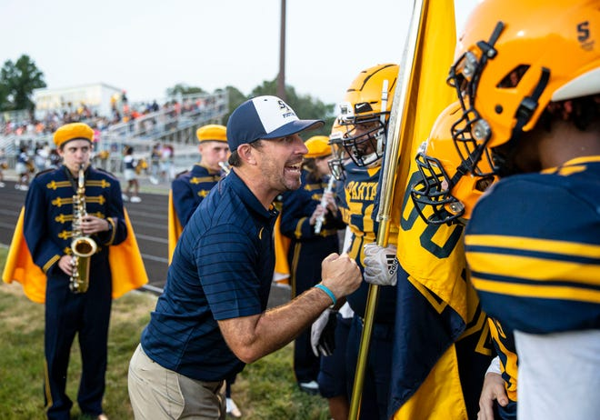 Southeast head football coach Matt Lauber pumps up his team before the Spartans take the field to take on Normal U-High at Southeast High School in Springfield, Ill., Friday, September 17, 2021. [Justin L. Fowler/The State Journal-Register]