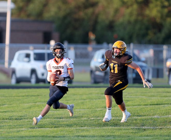 Mobridge-Pollock quarterback Holden Eisemann looks for an open target as Groton linebacker Colby Dunker chases him down during the first quarter of Friday's game in Groton. American News photo by Jenna Ortiz, taken 09/17/2021