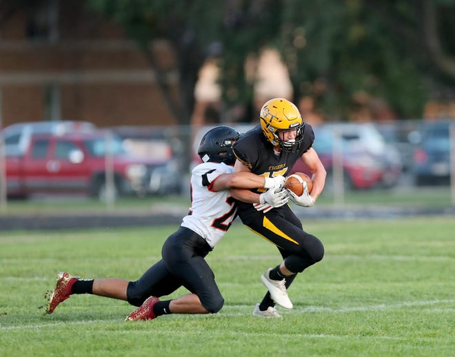 Groton running back Andrew Marzahn attempts to run as Mobridge-Pollock linebacker Trent Schmeichel  looks takes him down during the first quarter of Friday's game in Groton. American News photo by Jenna Ortiz, taken 09/17/2021