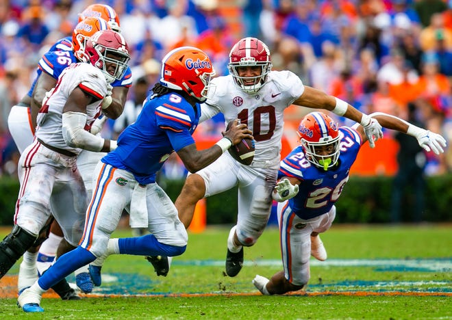 Florida quarterback Emory Jones scrambles as Alabama linebacker Henry To'oTo'o (10) pursues in the second half Saturday at Ben Hill Griffin Stadium. Jones completed 17 of 27 passes for 181 yards, with an interception.