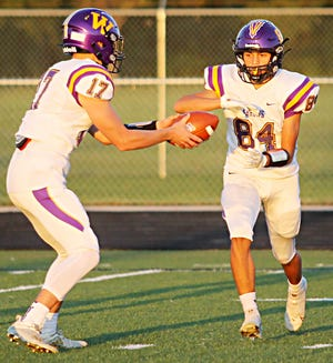 Watertown's Ashton First In Trouble (84) receives a handoff from quarterback Drew Norberg during their Eastern South Dakota Conference high school football game against Huron at Tiger Stadium. Andrew Czech's field goal gave the Arrows a 24-22 last-second victory.