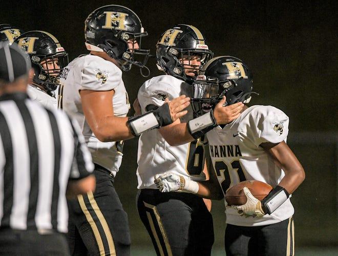 T.L. Hanna sophomore Vashun Burton (21) celebrates a touchdown on Sept. 17 in Easley.