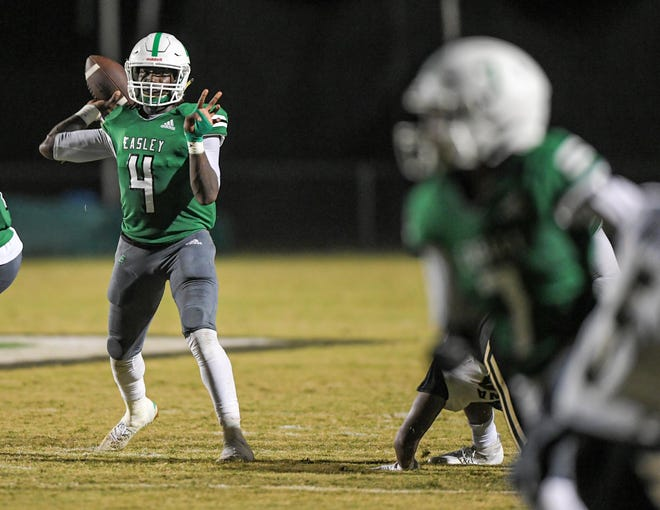 Easley senior AJ Brown (4) throws a touchdown pass to Easley junior Chris Clemons (7) during the second quarter in Easley, S.C. Friday, September 17, 2021.