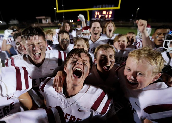 De Pere High School's Matthew Ahrenholtz, center, celebrates with teammates after defeating Bay Port High School during their football game Friday, September 17, 2021, at Bay Port High School in Suamico, Wis. De Pere won 19-15.Dan Powers/USA TODAY NETWORK-Wisconsin