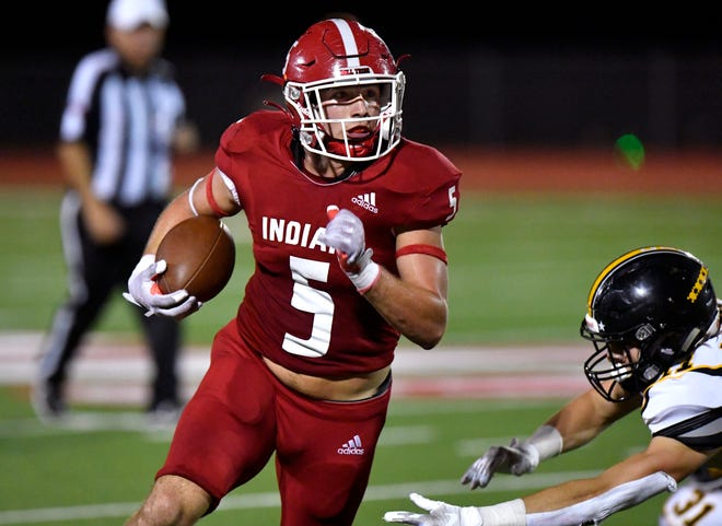 Jim Ned's Xavier Wishert carries the ball during Friday's game against Cisco in Tuscola. Final score was 28-14, Jim Ned.