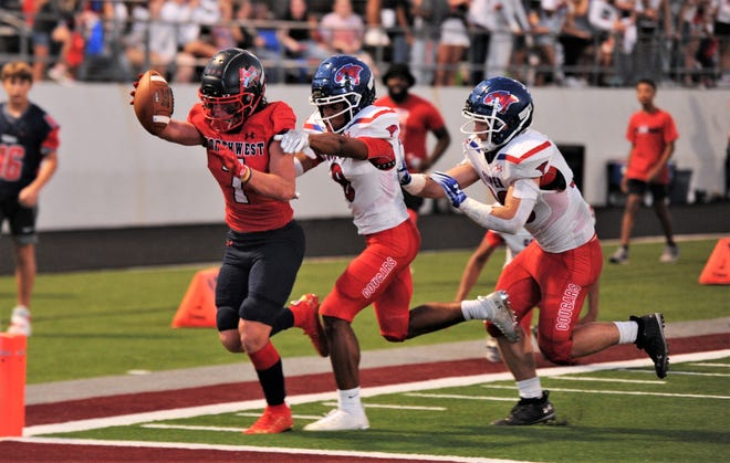 Justin Northwest receiver Joseph Rivas, right, runs toward the end zone as a pair of Cooper defenders give chase. The score put the Texans up 19-0 with 7:51 left in the first half.
