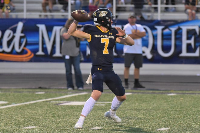 Stephenville quarterback Ryder Lambert (7) throws a pass during Friday's game against Wylie at Tarleton Memorial Stadium in Stephenville on Sept. 17, 2021. The Yellow Jackets pulled away in the second half to win 37-7.