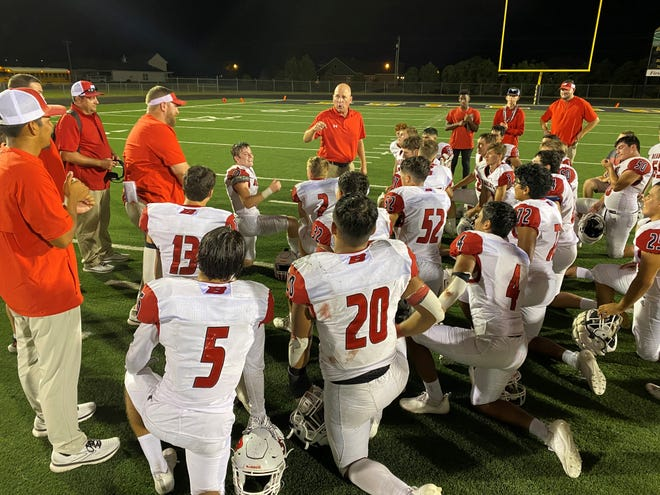 Ballinger coach Chuck Lipsey talks to his players about enjoying the win but looking toward the playoffs after Friday's 21-13 win at Clyde. Sept 17 2021