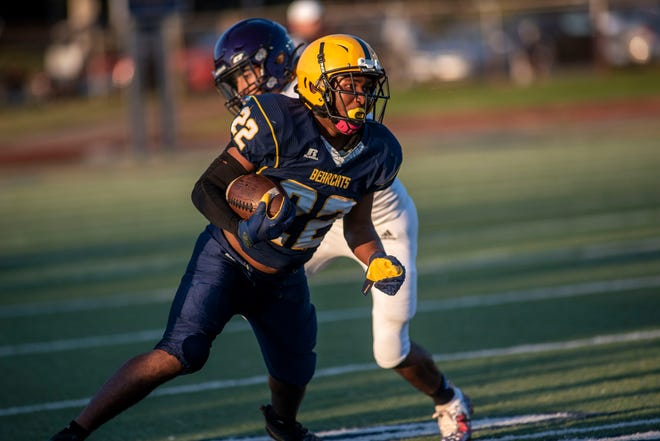 Battle Creek Central's Melvin Nelson (22) dodges Lakeview's Fidel Gonzalez III (9) on Friday, Sept. 17, 2021 at C.W. Post Stadium in Battle Creek, Michigan. Lakeview defeated Battle Creek Central 31-18.