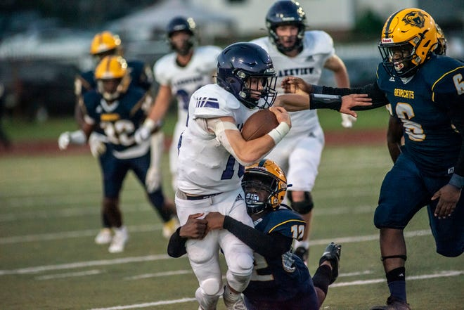 Battle Creek Central's Karlito Campbell (12) tackles Lakeview's Jacob Kucharczyk (16) on Friday, Sept. 17, 2021 at C.W. Post Stadium in Battle Creek, Michigan. Lakeview defeated Battle Creek Central 31-18.