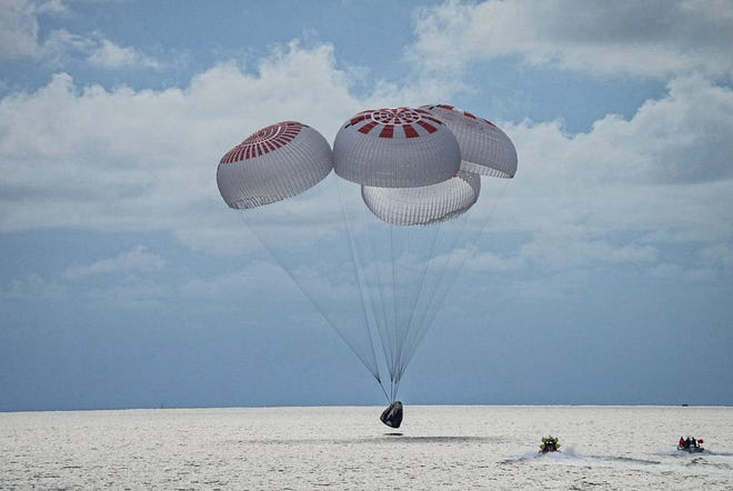 A SpaceX Crew Dragon capsule splashes down in the Atlantic Ocean to bring an end to the Inspiration4 mission on Saturday, Sept. 18, 2021.