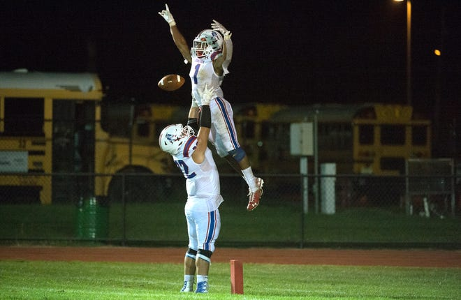 Washington Township's Jo'Nathan Silver is lifted by teammate Danny Guetens after Silver scored a touchdown during the 4th quarter of the football game between Washington Township and Clearview played at Clearview High School on Friday, September 17, 2021.