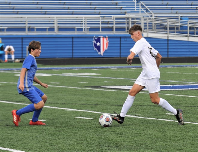 River View's Gage Summers (white) tries to dribble past a Zanesville defender in a win earlier this season. River View earned the top seed as the Division II boys soccer tournament draw was held on Sunday.