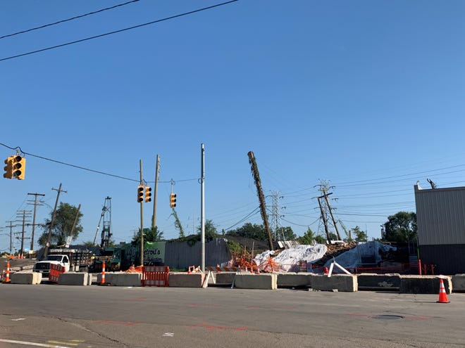 Multiple agencies are working together to determine what caused a mound to form last Saturday on West Fort Street and Dearborn Street, disrupting utility lines and emitting fumes at the time.