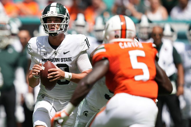 Michigan State Spartans quarterback Payton Thorne looks to pass against the Miami Hurricanes during the first half Saturday, Sept. 18, 2021, in Miami Gardens, Fla.