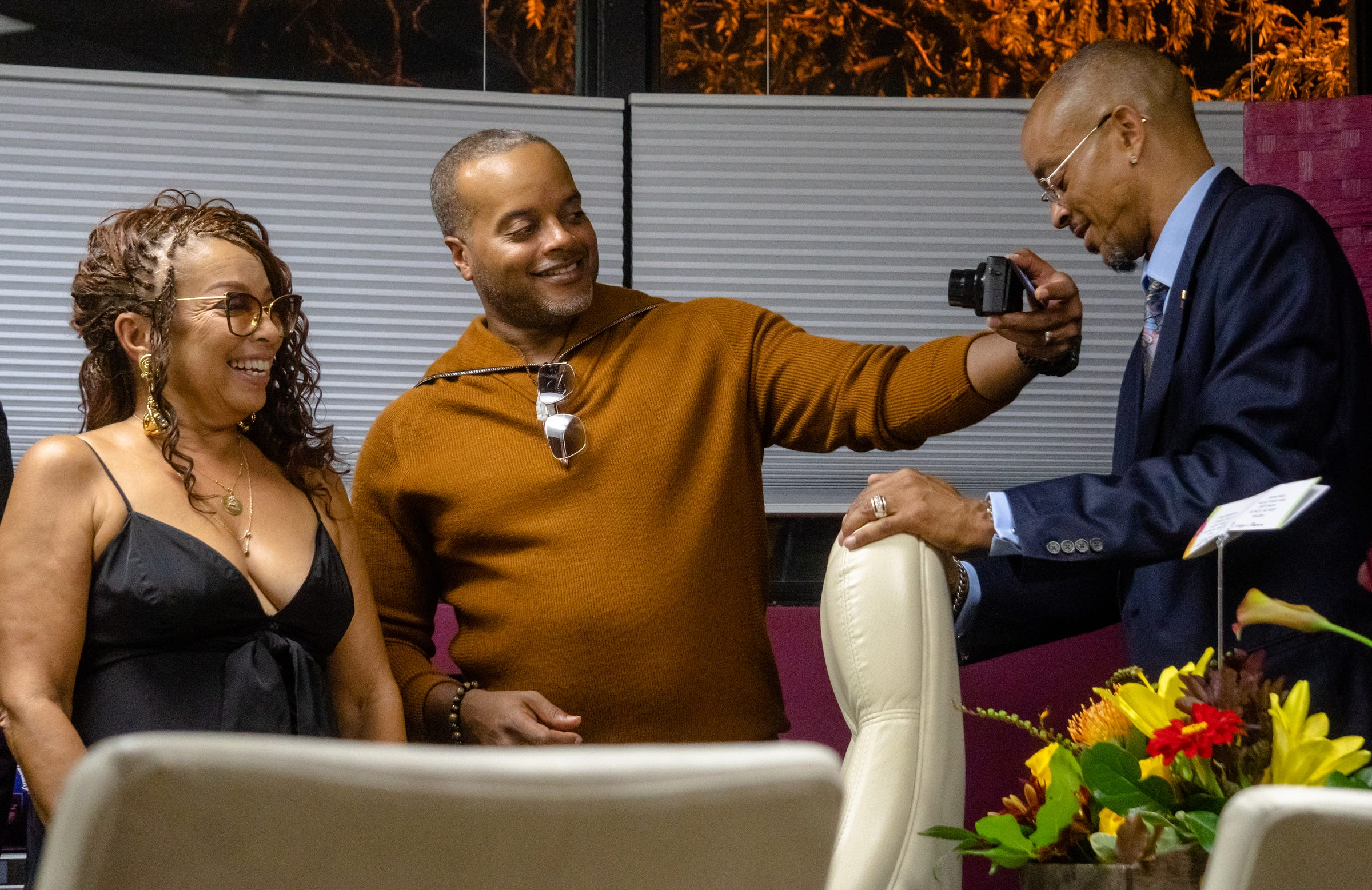 [LEFT to RIGHT] President of The Right Productions Shahida Mausi and her sons Rashid Mausi and Dorian Mausi in the offices of the Aretha Franklin Amphitheater during the 25 years of business celebration of The Aretha Franklin Amphitheater on September 17, 2021.