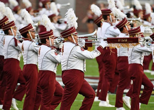 The Florida State University Marching Chiefs performing at a football game.