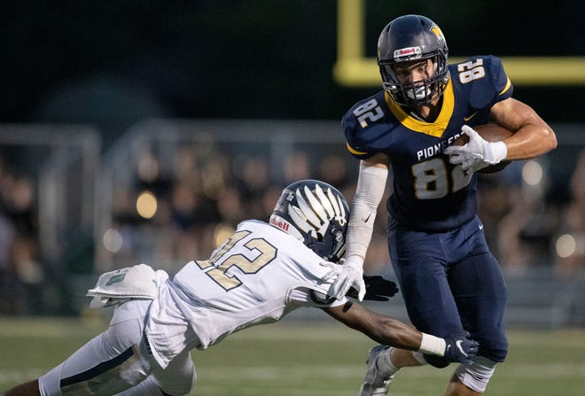 Mooresville High School's Logan Jackson (82) tries to keep the ball from Decatur Central's William Starks (12) during the first half of the game Friday, Sept. 17, 2021, at Mooresville High School.
