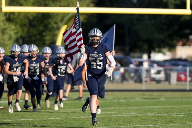 Central Catholic's Leo Bordenet (55) leads the Central Catholic team onto the field before the first quarter of an IHSAA football game, Friday, Sept. 17, 2021 in Lafayette.