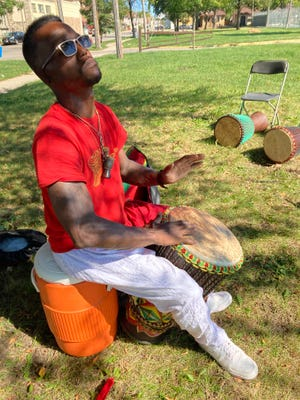 Ryan Washington, owner of The Village Drum Company, provided entertainment for residents