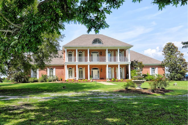 A five-bedroom, four-bath estate home and 15 acres at 3041 Mathews Road is for sale. The property is priced at $899,900 and provides 4,700 square feet of living space.