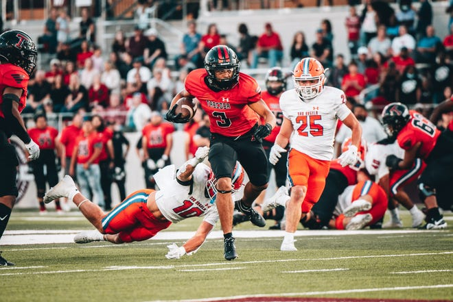 Amarillo Tascosa's Tayden Barnes (3) evades a tackle attempt by San Angelo Central's Ty Casey (10) and Jacob O'dell (25) on Friday at Buffalo Stadium in Canyon.