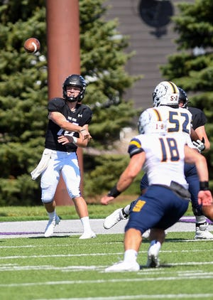 University of Sioux Falls quarterback Adam Mullen throws a pass on Saturday, September 18, 2021, at Bob Young Field in Sioux Falls.