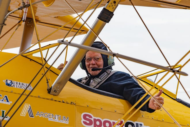 John Haynes gives a thumbs-up before taking off in a Boeing Stearman biplane Saturday, Sept. 18, 2021. The veteran was provided this experience through the non-profit organization Dream Flight.