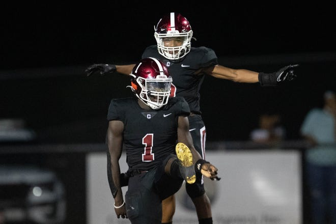 Chiles' Tre'avis Jones (1) celebrates with a teammate after scoring a touchdown during a game between Chiles and Madison County at Chiles High School Friday, Sept. 17, 2021.