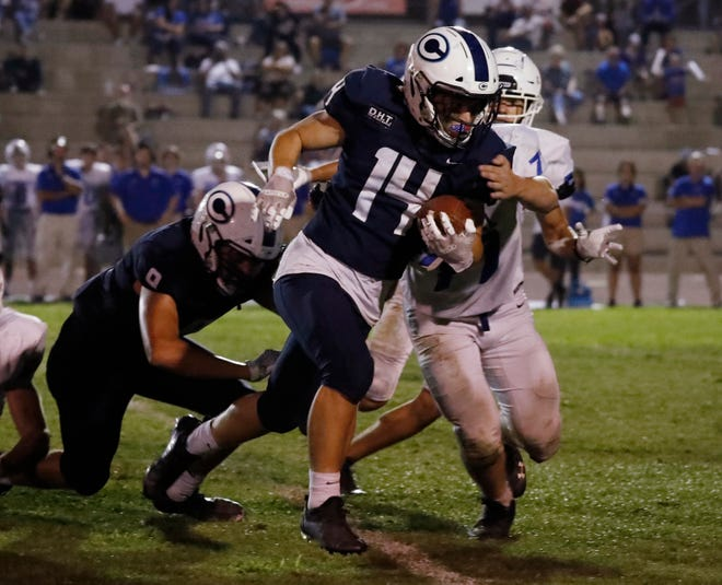 Central Valley Christian's Cooper Nolan gets some hard yards against Immanuel in their football game in Visalia, Calif., Friday, Sept. 17, 2021.