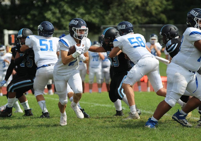 Dobbs Ferry's Robert Sanzo (2) looks for some running room during the Eagles' 56-0 win at Rye Neck on Sept. 18, 2021.