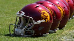 A view of USC football helmets on the field at the LA Coliseum.