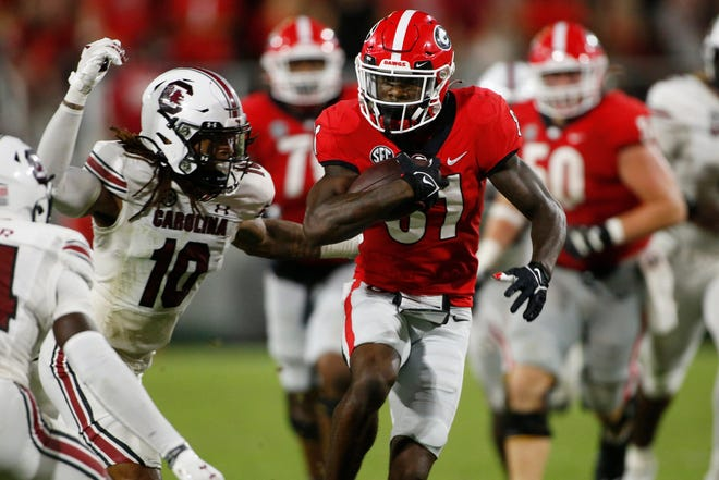 Georgia wide receiver Marcus Rosemy-Jacksaint (81) drives the ball down the field during the second half of an NCAA college football game between South Carolina and Georgia in Athens, Ga., on Sept. 18, 2021. Georgia won 40-13.  News Joshua L Jones