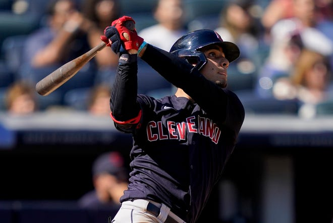 Cleveland's Andres Gimenez hits a three-run home run off New York Yankees relief pitcher Albert Abreu in the fifth inning of Cleveland's 11-3 win Saturday afternoon. [John Minchillo/Associated Press]
