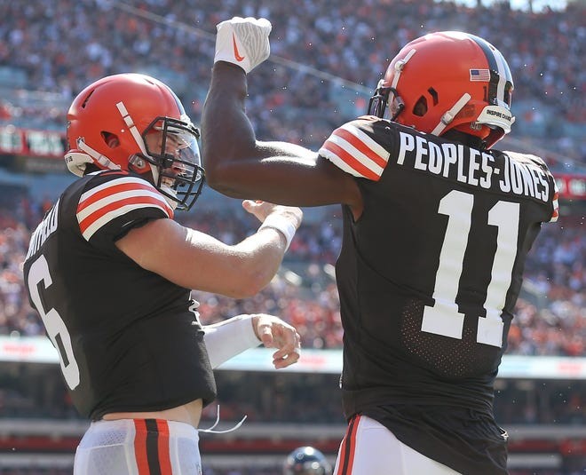 Cleveland Browns quarterback Baker Mayfield (6) celebrates with Cleveland Browns wide receiver Donovan Peoples-Jones (11) after scoring a rushing touchdown during the first half of an NFL football game, Sunday, Sept. 19, 2021, in Cleveland, Ohio. [Jeff Lange/Beacon Journal]