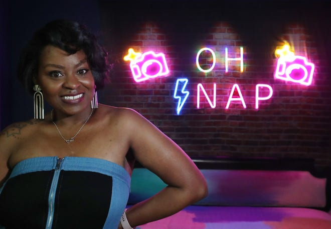 Tiffany Roper, owner of OH SNAP, shows off the selfie museum and event space Saturday on South Main Street in Akron.