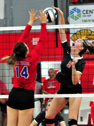 Loudonville High School's Katie Seboe hits the ball to West Holmes High School as West Holmes' Avery Yoder tries to stop it during a volleyball game at Loudonville High School Saturday, Sept. 18, 2021.  LIZ A. HOSFELD/FOR TIMES-GAZETTE.COM
