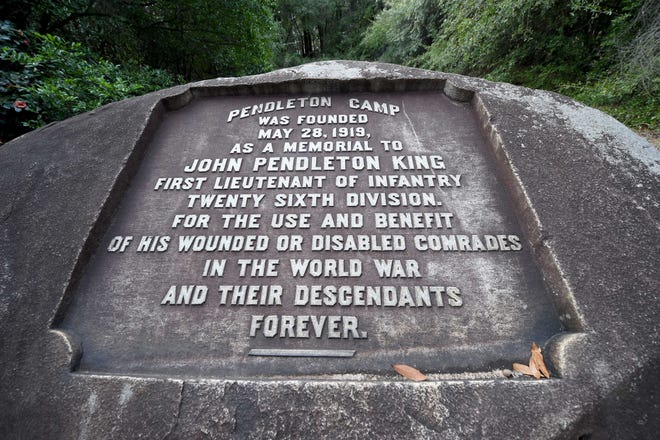 A granite boulder is inscribed as a memorial to John Pendleton King at Pendleton Camp in Augusta.