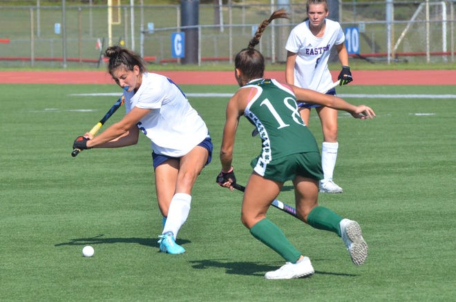 Eastern senior Isabella Bianco tries to get a shot off as Camden Catholic junior Ava Moore closes in