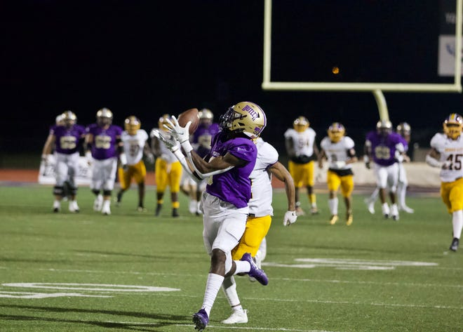 Butler's Darius Lassiter catches a deep pass from quarterback Gavin Screws in Saturday's 30-20 win over Dodge City at BG Products Veterans Sports Complex in El Dorado, Kansas.