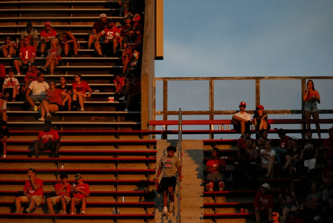 Fans sit in the upper deck during the fourth quarter of a NCAA Division I football game between the Ohio State Buckeyes and the Tulsa Golden Hurricane on Saturday, Sept. 18, 2021 at Ohio Stadium in Columbus, Ohio.